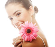 Young beautiful woman with pink flower Royalty Free Stock Photos