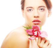 Young beautiful woman with pink flower Royalty Free Stock Photography