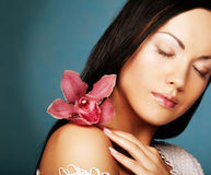 Young beautiful woman with pink flower Stock Photo