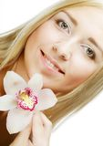Young beautiful woman with pink flower Stock Images