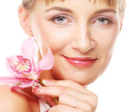 Young beautiful woman with pink flower Stock Photography