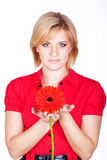 Young beautiful woman with pink flower. studio portrait Stock Image