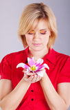 Young beautiful woman with pink flower. studio portrait Stock Photography