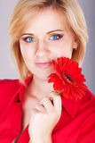 Young beautiful woman with pink flower. studio portrait Stock Photos