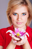 Young beautiful woman with pink flower. studio portrait Royalty Free Stock Images
