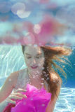 Young beautiful woman with pink flower underwater Royalty Free Stock Photos