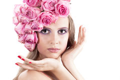 Young beautiful woman with pink flowers Stock Photo