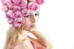 Young beautiful woman with pink flowers Royalty Free Stock Photography
