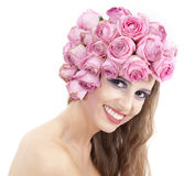 Young beautiful woman with pink flowers. On her head over white Stock Photo