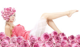 Young beautiful woman with pink flowers. On her head and in pink dress Stock Photography