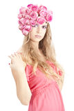 Young beautiful woman with pink flowers. On her head and in pink dress Royalty Free Stock Photo