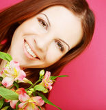 Young beautiful woman with pink flowers Royalty Free Stock Images
