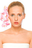 Young beautiful woman with pink orchids in hair Royalty Free Stock Photos