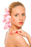 Young beautiful woman with pink orchids in hair royalty free stock images