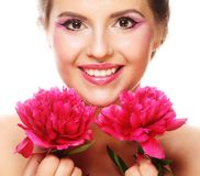 Young beautiful woman with pink peony Royalty Free Stock Images