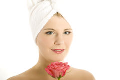 Young beautiful woman with pink rose Royalty Free Stock Image