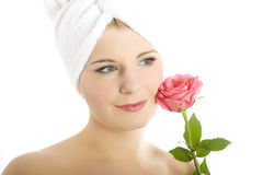 Young beautiful woman with pink rose Stock Images