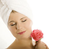 Young beautiful woman with pink rose Royalty Free Stock Images