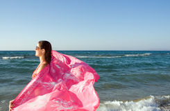 Young beautiful woman with pink shawl Royalty Free Stock Photography