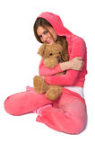 Young beautiful woman in the pink sportswear Stock Image
