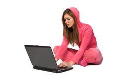 Young beautiful woman in the pink sportswear Royalty Free Stock Photography