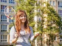 Young beautiful woman playing badminton Royalty Free Stock Photos