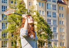 Young beautiful woman playing badminton Stock Image