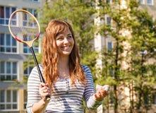 Young beautiful woman playing badminton Royalty Free Stock Image