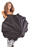 Young beautiful woman playing with black umbrella Stock Photography