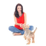 Young beautiful woman playing with his little dog yorkshire terr Stock Photo