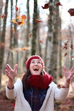 Young beautiful woman plays with beech leaves in one of the most amazing beech forest in Europe, La Fageda d'en Jorda. Young beautiful woman plays with beech royalty free stock images