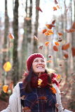 Young beautiful woman plays with beech leaves in one of the most amazing beech forest in Europe, La Fageda d'en Jorda. Stock Image
