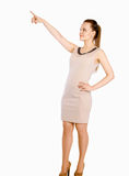 Young beautiful woman pointing at copyspace, Stock Photos