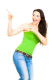 Young beautiful woman pointing to copyspace Royalty Free Stock Photo