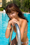 Young beautiful woman in pool Royalty Free Stock Image