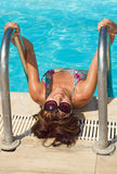 Young beautiful woman in pool Royalty Free Stock Images