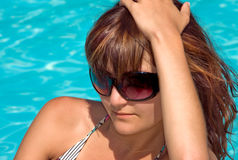 Young beautiful woman in pool stock photos