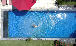 The young beautiful woman  in the pool, flat lay,view from drone Stock Images
