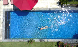 The young beautiful woman  in the pool, flat lay,view from drone Stock Image