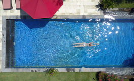The young beautiful woman  in the pool, flat lay,view from drone Stock Photo