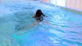Young beautiful woman in pool stock video