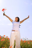 Young beautiful woman in poppy field Stock Photography