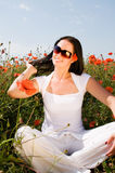 Young beautiful woman in poppy flowers Royalty Free Stock Image
