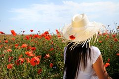 Young beautiful woman in poppy flowers Stock Photo