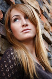Young beautiful woman portrait. On a brick wall stock images
