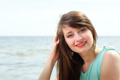 Young beautiful woman portrait on the beach Royalty Free Stock Image