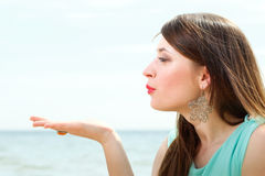 Young beautiful woman portrait on the beach Royalty Free Stock Photo