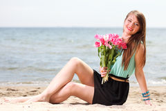 Young beautiful woman portrait on the beach bunch flower Royalty Free Stock Images