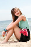 Young beautiful woman portrait on the beach bunch flower Royalty Free Stock Photos
