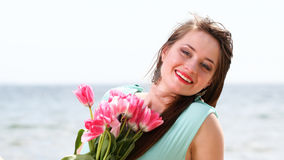 Young beautiful woman portrait on the beach bunch flower Royalty Free Stock Photography